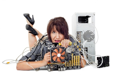 frustrated woman lying down holding computer motherboard photo