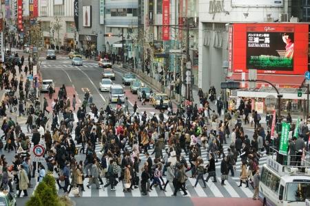 TOKYO - NOVEMBER 25: People crossing street at Hachiko crossroad in Shibuya district on November 25, 2011 in Tokyo, Japan. Editorial