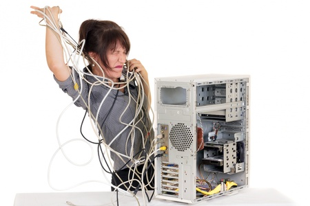 hysteria: business woman going insane with damaged computer Stock Photo