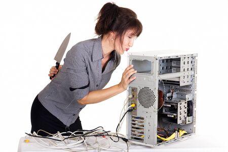 technophobe: woman kissing computer before killing it