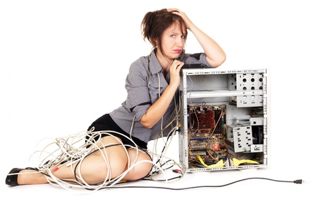 confused person: worried woman pouting on broken computer