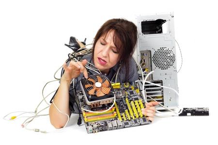 broken computer: woman looking computer processor cooler fan to repair it