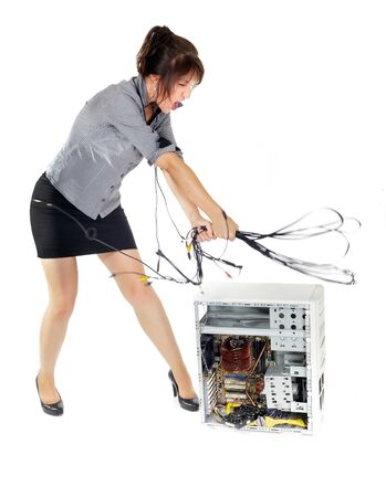 crazy business woman whipping computer with wires Stock Photo - 15177064