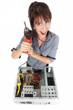 insane: crazy business woman going repairing computer with drill