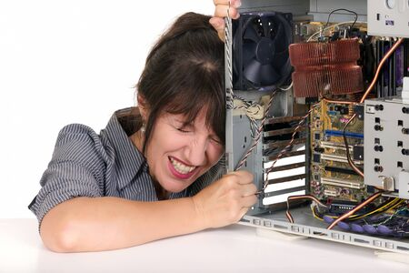 technophobe: displeased woman with broken computer Stock Photo