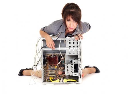 hopeless woman and her broken computer photo