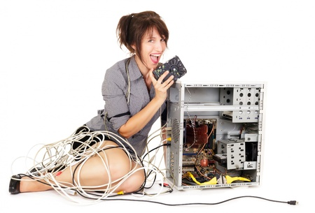 ecstatic woman holding hard disk trying to repair computer photo