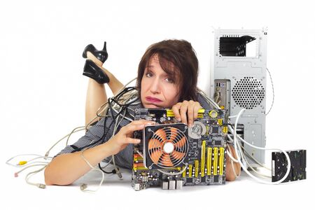 woman lying down holding computer motherboard photo