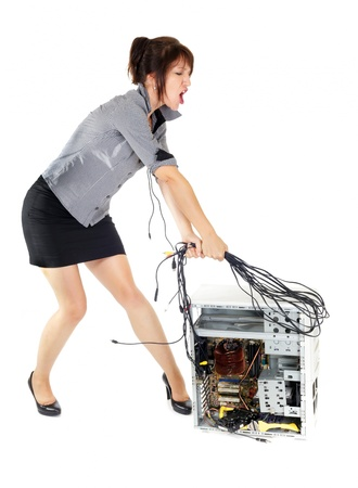 furious business woman whipping computer with cables Stock Photo