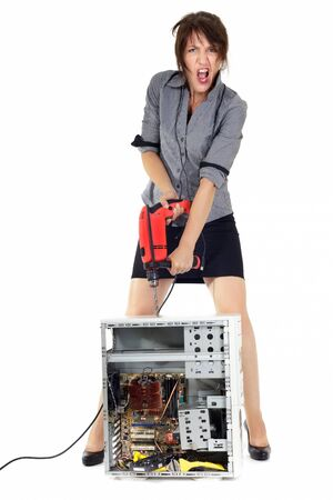 destroying: insane business woman destroying computer with electric drill