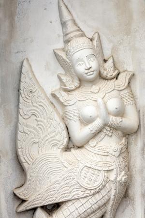 stone carving: buddha white traditional sculpture in wat Arun temple, Bangkok, Thailand