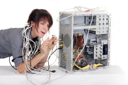 ビジネスの女性の非常にコンピューターのプラグと混同 写真素材