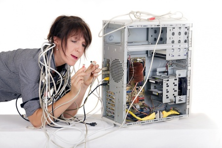 business woman very confuse with computer plugs Stock Photo - 15460536