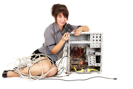 computer help: woman holding hard disk drive trying to repair computer Stock Photo