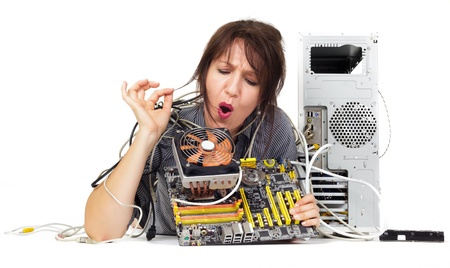 find solution: woman trying to find solution on computer motherboard Stock Photo