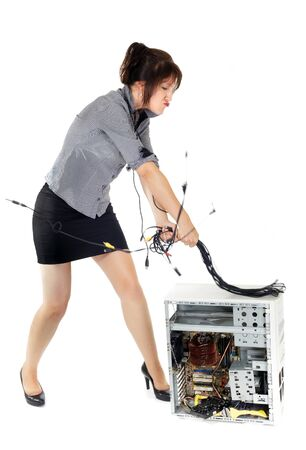 furious woman whipping computer with cables photo