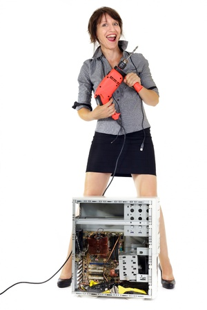 electric drill: ecstatic business woman destroying computer with electric drill