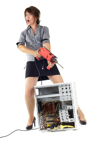 destroying: woman want to kill computer with electric drill