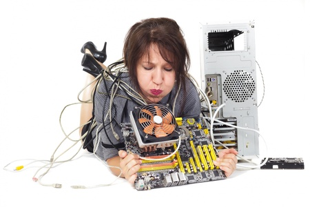 woman lying down and blowing computer processor cooler fan photo