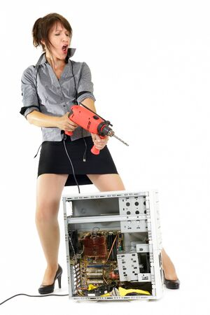 electric drill: businesswoman want to destroy computer with electric drill Stock Photo