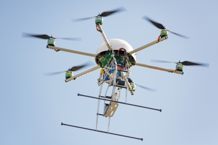 uav drone hexarotor flying in blue sky Stock Photo