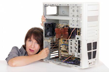 technophobe: sad woman having problem with computer Stock Photo