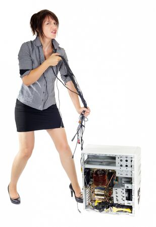 business woman whipping computer with electronic cables photo