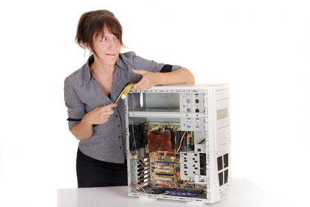 pensive woman in confusion with broken computer photo
