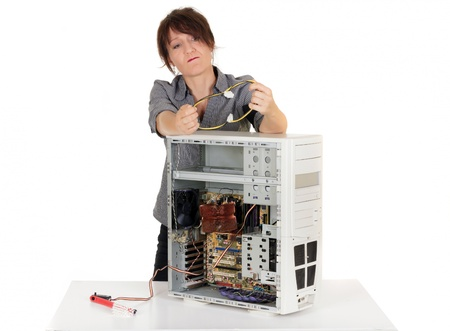 unhappy worker: woman having problems trying to understand her computer