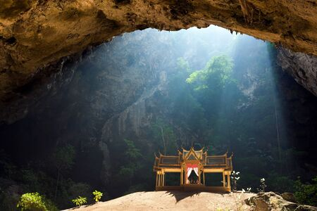 Morning sunbeam on golden buddhist pavilion in wild cave, Sam Roi Yot, Thailand photo