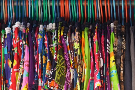 Casual clothes hanging in market, Thailand photo