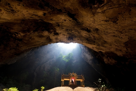 phraya: Ethereal morning light in sacred cave and golden temple, Sam Roi Yot, Thailand