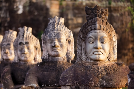 Figures guardians statues of Angkor Thom south door, Cambodia photo