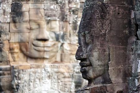bayon: Mysterious face statues in Bayon temple, Angkor, Cambodia Stock Photo