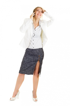 Full length business woman phoning and smiling over white background photo