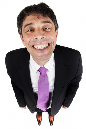 Quirky high angle portrait of a stylish businessman giving a cheesy grin with his face raised to the camera Stock Photo - 20537551