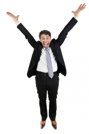 Jubilant businessman man cheering and raising his outstretched arms into the air in celebration, isolated on white