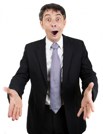 Overjoyed businessman with a pleased expression and his mouth open extending his hands in welcome, isolated on white Stock Photo - 20537606