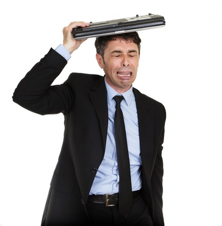 teary: Crying businessman sheltering under his laptop blubbing his heart out in grief, upper body portrait isolated on white Stock Photo