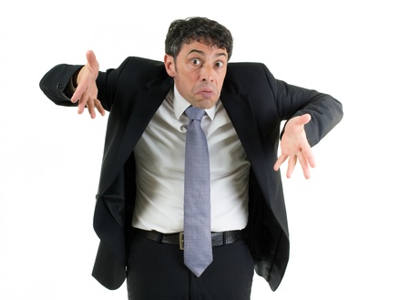 shrug: Expressive businessman shrugging his shoulders in ignorance or indifference and gesturing with his hands isolated on white