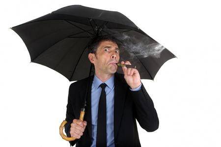 propylene: Man holding umbrella and smoking electronic cigarette