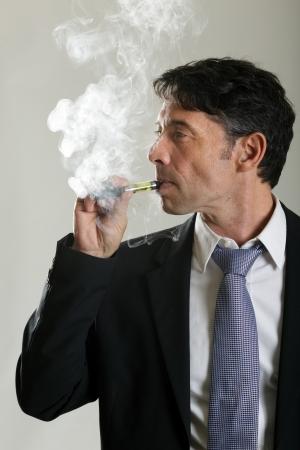 atomiser: Man smoking electronic cigarette