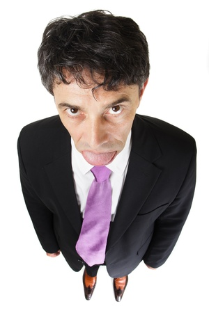stood up: High angle full length portrait of a down-trodden businessman standing with his arms at his sides looking up under his eyebrows at the camera isolated on white