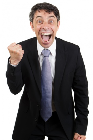 Jubilant business man cheering with his mouth open, an excited expression and making a fist with his hand , isolated on white Imagens