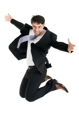 Agile stylish middle-aged businessman leaping in the air for joy isolated on white Stock Photo - 20537447
