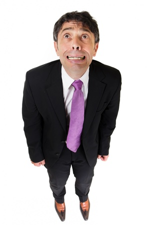 imploring: Desperate businessman shot from above, isolated on white