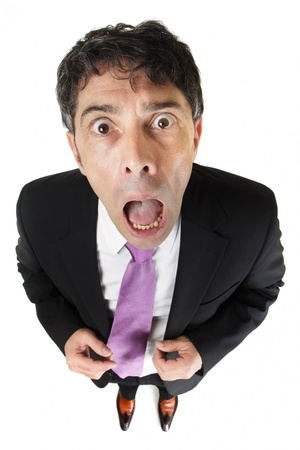aghast: High angle full length portrait of an appalled businessman looking up at the camera with his mouth open in horror isolated on white Stock Photo