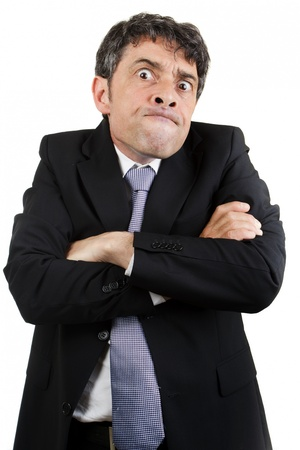 Businessman is pulling a face with arms crossed photo