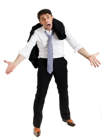 misery: Despairing businessman standing with hunched shoulders, outstretched imploring hands and an anguished expression, isolated on white Stock Photo
