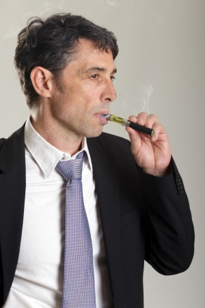 propylene: Businessman smoking electronic cigarette Stock Photo